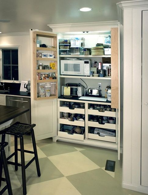 Behind-the-door storage for appliances, plus other great examples of kitchens featuring pantries in the cabinets. | Designer: The French Tradition