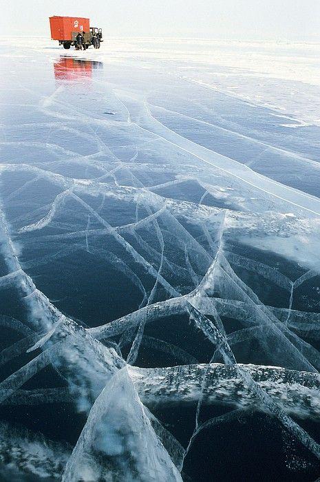 Frozen lake. A truck sits on the frozen surface of Lake Baikal, Siberia. Russia.  Ria Novosti.