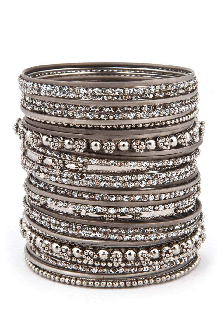 Cara Accessories The More the Merrier Bangle Set - Available in both gold and silver this enormous stack of bangles will make you look like you paid a pretty penny, when in reality they'll only set you back $8!
