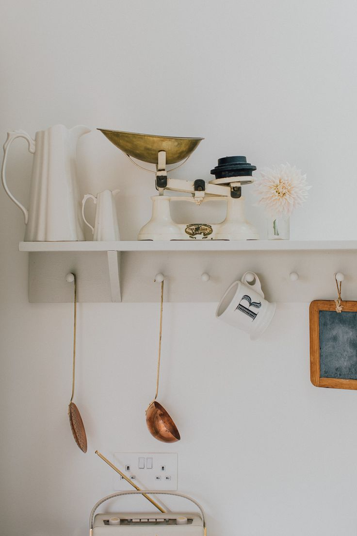 Peg board shelf with vintage scales