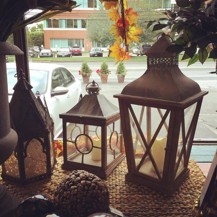 Lanterns make GREAT centerpiece ideas! fill with small pumpkins or greens. www.darbyroad.com