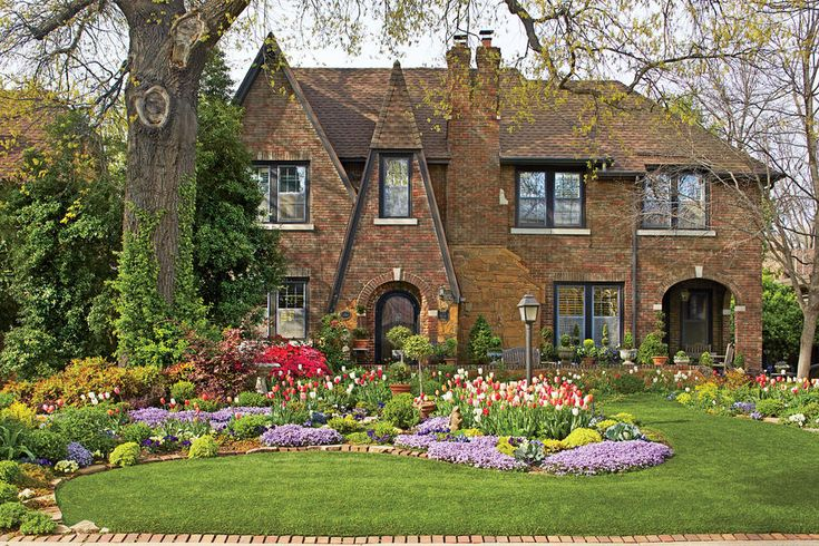 """Inspired by the Setting - Here's How a Self-Taught Gardener Grows Over 800 Tulips Every Spring  - Southernliving. """"I have an English-style garden because I have an English Tudor house. If I had a different house, I'd have a different-style garden. They have to speak the same language."""" She designed everything in her front yard around that beloved oak tree—even using its shade line to define the shapes of her flowerbeds. Where she couldn't grow grass for lack of sun under the tree, she tore…"""