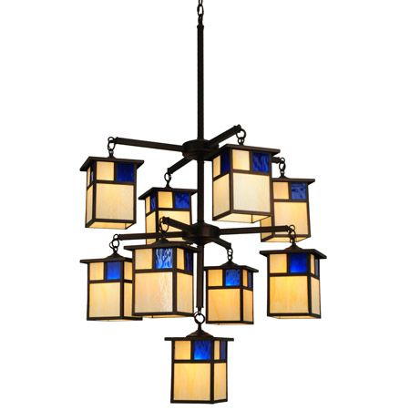 Stunning nine light craftsman chandelier made with beige and dark blue art glass.