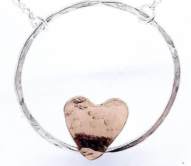 Sterling silver circle and heart necklace, rose gold vermeil heart, circle of love minimalist jewellery. Silver hammered circle necklace. by LillyAlexandraSilver on Etsy https://www.etsy.com/uk/listing/569127809/sterling-silver-circle-and-heart