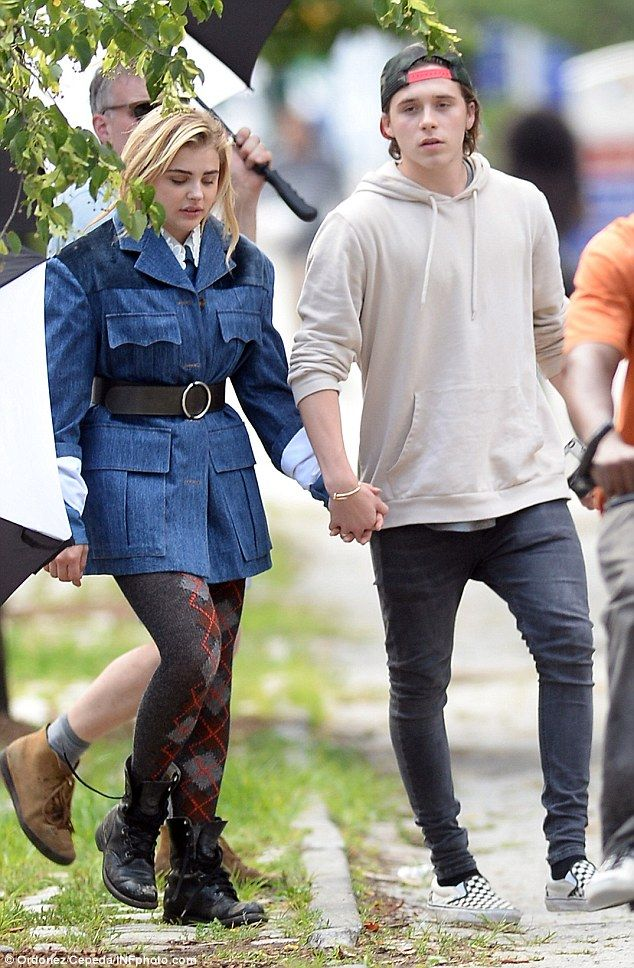 PDA: Actress Chloe Grace Moretz held hands with boyfriend Brooklyn Beckham as he joined her on the set of a fashion shoot in New York City on Wednesday
