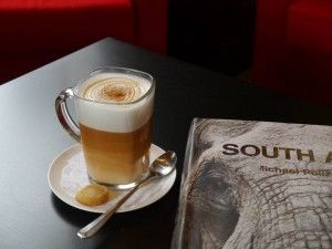 South African red espresso — made from rooibos leaves finely ground through an espresso machine. Lattes have a sweet, earthy flavor. Americano -two shots of tea & hot water. Cappuccino with cinnamon, honey, a shot, steamed milk. Rooibos Fresh: two shots mixed with apple juice & iced. Traditional South African sweets: koeksister (a syrup-soaked donut); jam-filled coconut tartlets (Hertzog tea cakes); ystervarkies (chocolate/coconut-dipped cakes). Cederberg Tea House, 1417 Queen Anne Ave N