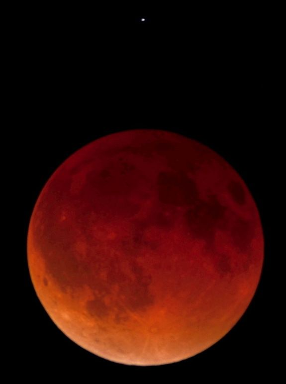 Total Lunar Eclipse Pictures from April 15, 2014 | Space.com..  Astrophotographer Joel O'Bryan's image of the total lunar eclipse and star Spica taken from Mt. Lemmon, Tucson see more Blood Moon Photos at the link: