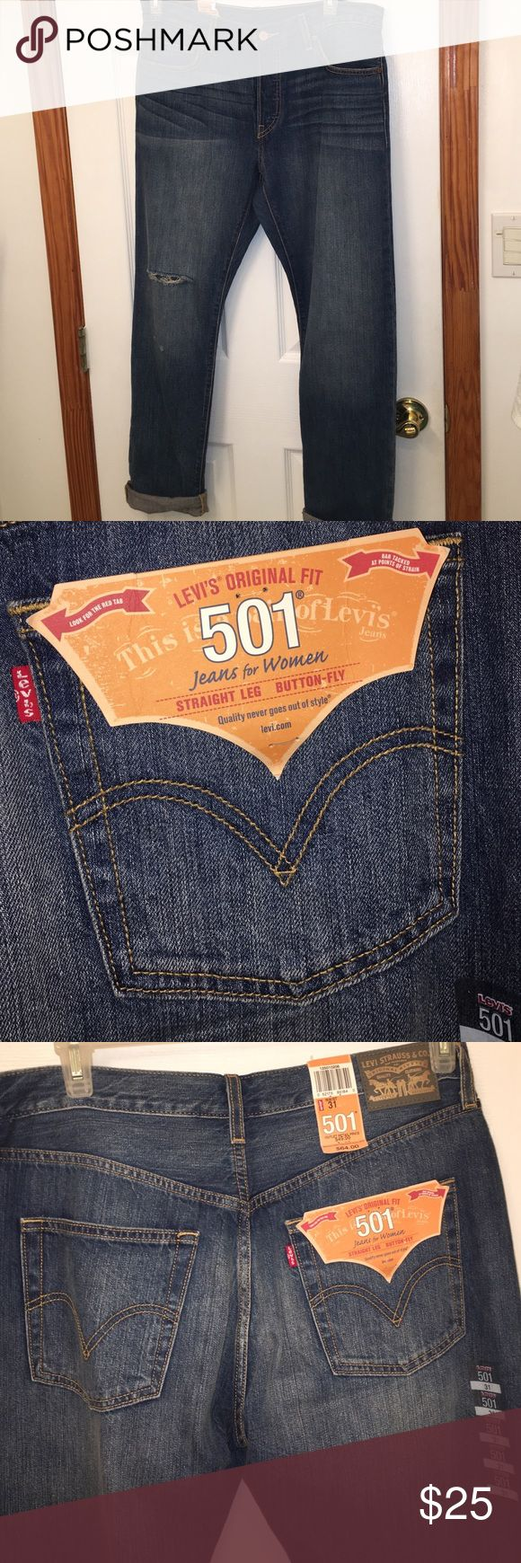Levi Strauss: Authentic Women's Straight Jean Authentic Levi Strauss 501's–purchased at the Levi Outlet store. 31 Waist. Originally $64.00, BRAND NEW. Has one distressed hole on the right leg for design. 4 inner button up instead of zipper! Can be worn casual or dressed up. Levi's Jeans Straight Leg