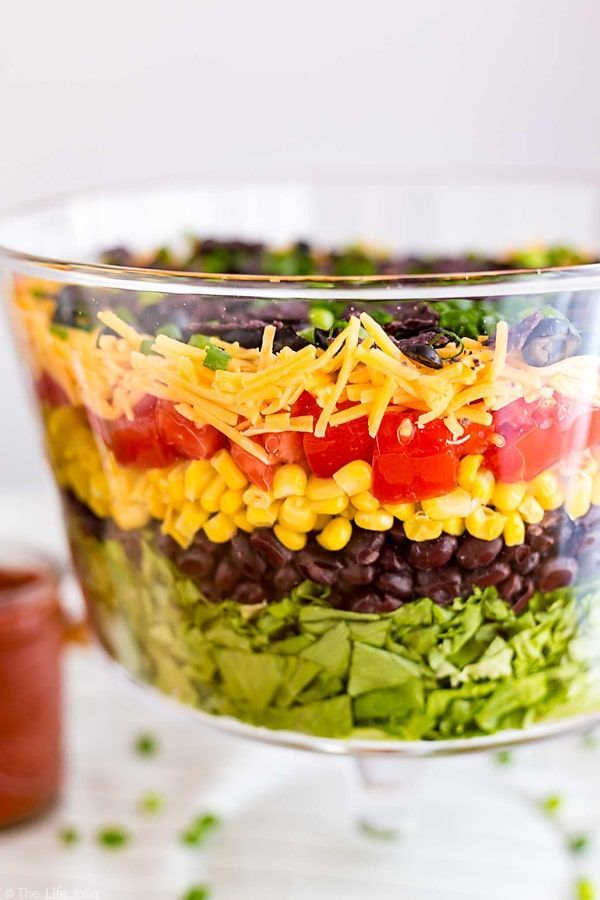 This 7 Layer Taco Salad Is An Easy Recipe To Make For Parties Full Of Delicious Mexican In Layered Taco Salads Mexican Food Recipes Easy Mexican Salad Recipes