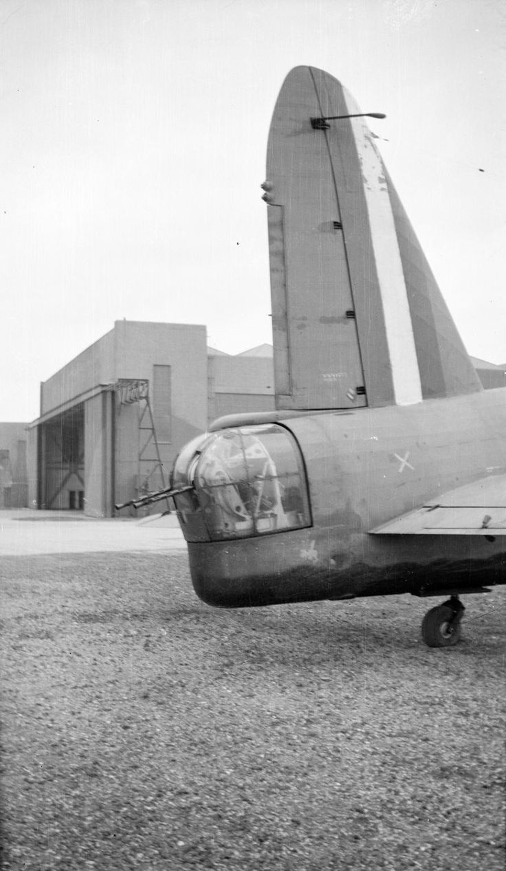Paul Nash 'Black and white negative, tail of Vickers Wellington bomber and hangar [Cowley?]', 1940 © Tate