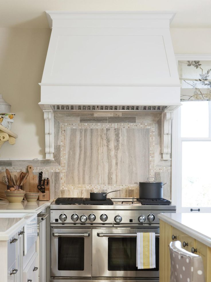 The 48-inch gas range is the same kind used in commercial kitchens. You'll need a commercial vent, too, so make sure you budget for one. They start at around $1,000. I designed a custom cover to help this one blend in with the cabinetry.