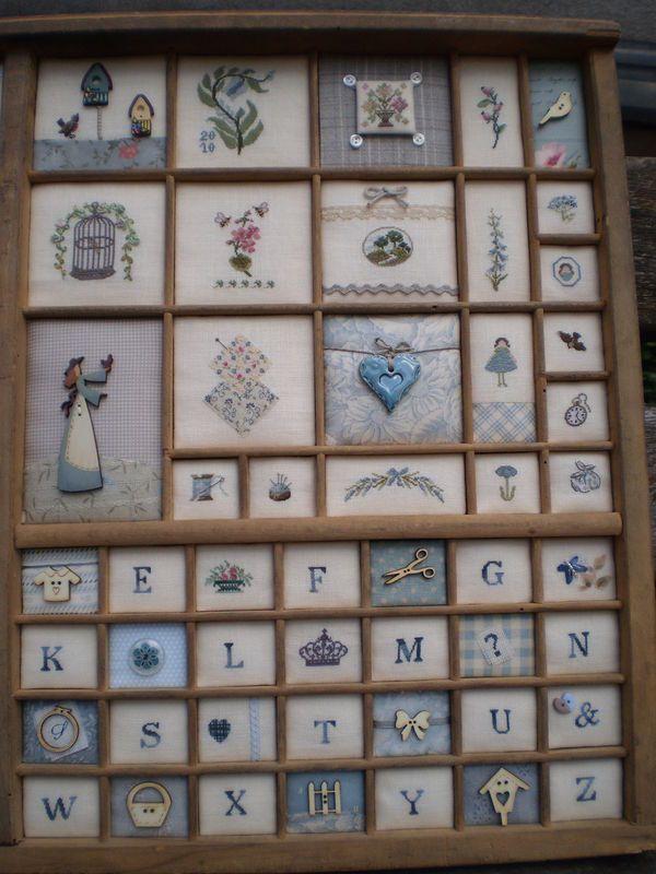 cross-stitch alphabet; old printers' drawer