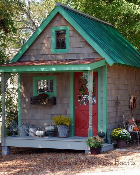 This bold little potting shed gets a full themed costume every season! For fall, planters of mums and pumpkins galore line its mini porch. Could you imagine a better spot to inspire your green-thumb?