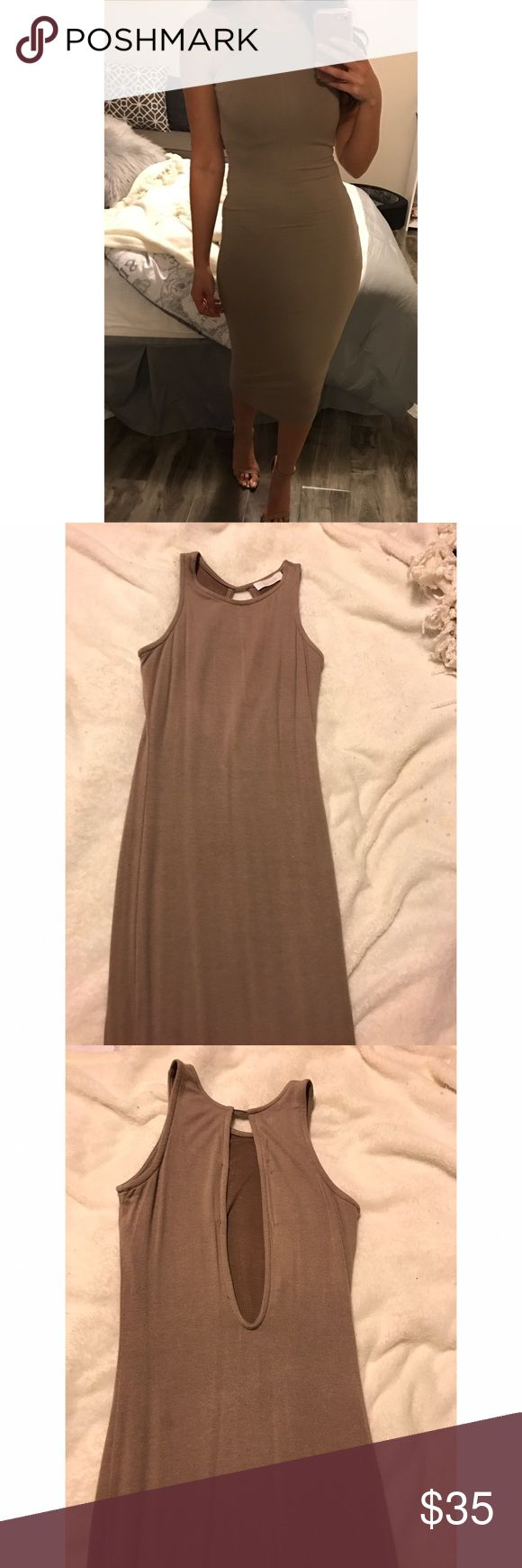 Nude Dress Worn 2-3 times. Good condition. Nude bodycon dress. Goes over knees. Open back. Kaitlyn Dresses