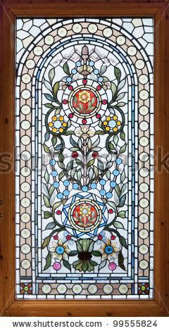 Stained glass window with floral motif.