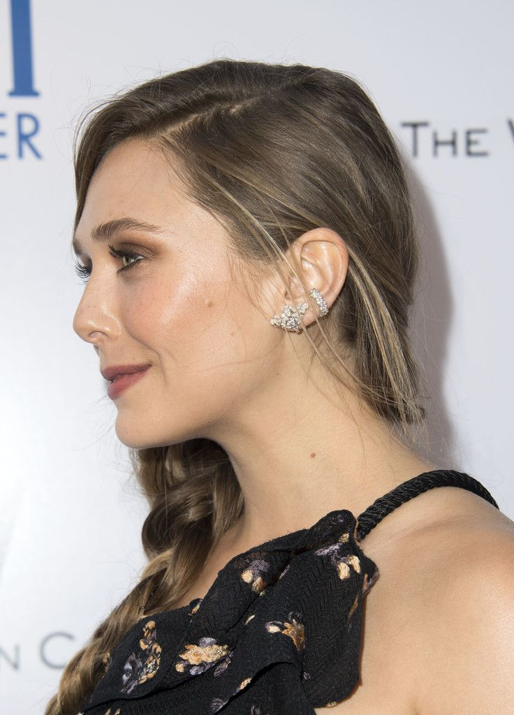 "Elizabeth Olsen Photos Photos - Actress Elizabeth Olsen (details of the earing) attends the Weinstein Company 'Wind River"" Los Angeles Premiere at the theater at Ace Hotel, on July 26, 2017, in Los Angeles, California. / AFP PHOTO / VALERIE MACON - Premiere of The Weinstein Company's 'Wind River' - Arrivals"
