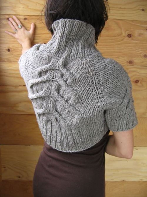 Knitted shrug by  Melissa Halvorson. love the cable choice for the back