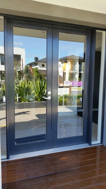 Carlisle Canterbury front glazed door painted black (or dark) to tie in with black aluminium window frames Dulux colour Domino PG1A8