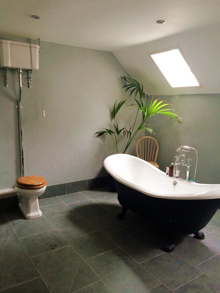 Beautiful #victorian #bathroom complete with roll-top bath.  Floor used is Natural Brazilian Grey Riven Slate 60x30 and 30x30 #naturalstone #greytiles #bathroominspiration #periodfeatures #stonetiles http://mrs-stone-store.com/natural-slate-tiles/grey-natural-slate-tiles/