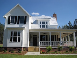 Metal Roof Clapboard Siding White Paint Large Porch And Windows With Shutters All Define The Cottage Style