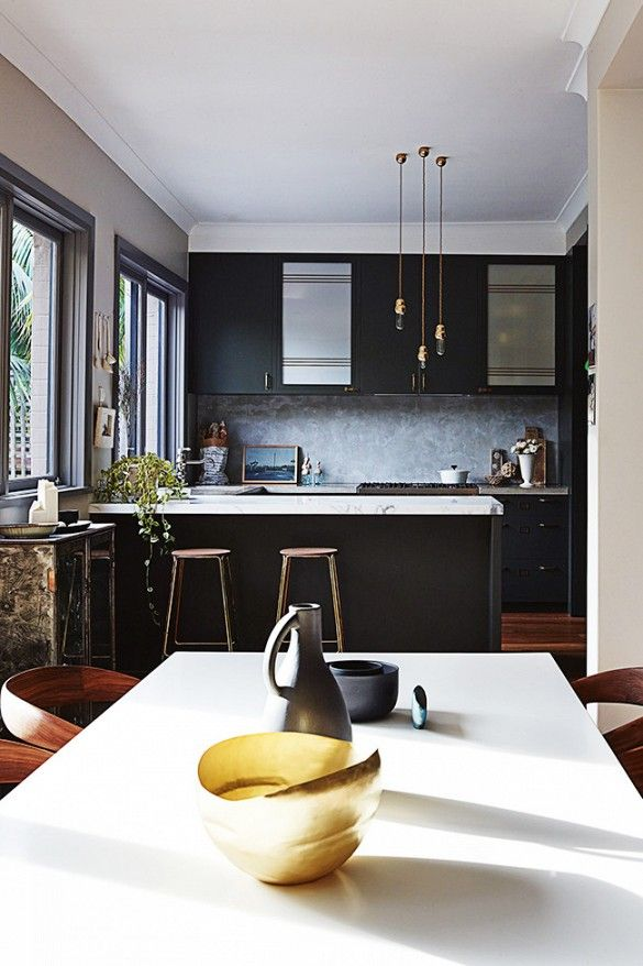 black modern kitchen with white marble counters