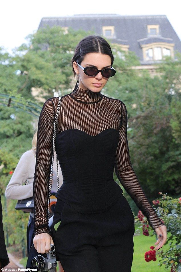 Fashion darling! Looking like a character from 90s cult film The Craft, the fashion darling parted her locks in the centre and into a low chignon as she protected her peeps with a oval shaped shades