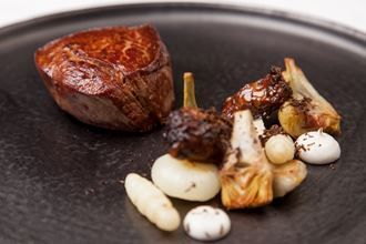 Beef fillets with braised oxtail and artichokes
