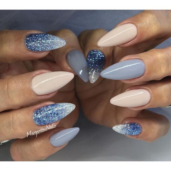 Nude and blue almond nails