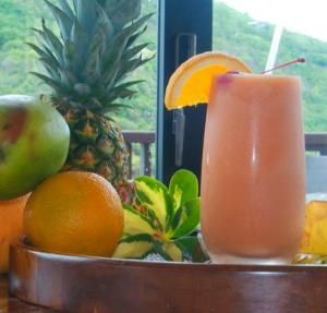 tropical depression | 1 oz. mango puree  1 oz. strawberry puree  1/2 oz. triple sec  1/2 oz. amaretto  1/2 oz. dark rum  1/2 oz. coconut cream  Garnish of cherry, pineapple wedge and toasted coconut     1.  Combine all the ingredients in a blender with ice. Blend until smooth and serve in a cocktail glass garnished with a cherry, pineapple wedge and toasted coconut.