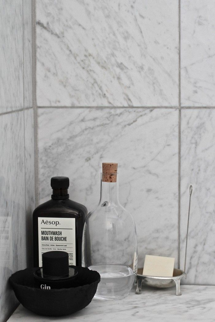 bathroom details black and white with a touch of colour from the Ikea sinnerlig bottle