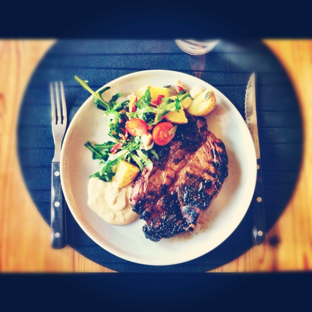 Barbecued pork chop with a warm potato-arugula-salad and a great BBQ sauce. From instagram @Rebecka Karlsson.