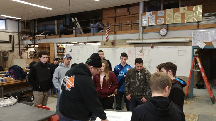 Students at Woonsocket Area Career & Tech working on one of the showcases for the #RIHomeShow2016 #carpentry #construction #building #education #schools #students