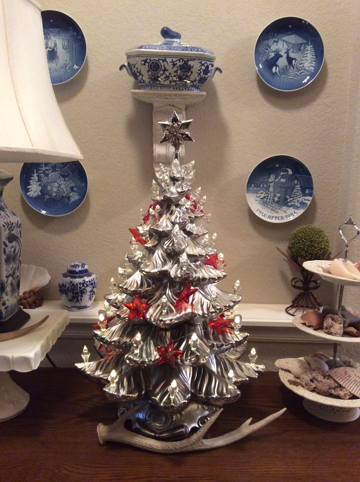 """Refurbished ceramic Christmas tree  Final result after spray painting old ceramic tree with Krylon """"Looking Glass"""" spray paint & replacing colored bulbs with clear plastic crystals. New star at the top & Voila!  A new modern Christmas tree!"""
