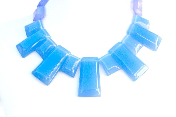 1980s  plastic bib necklace. Tabular beads of pale blue and purple plastic…