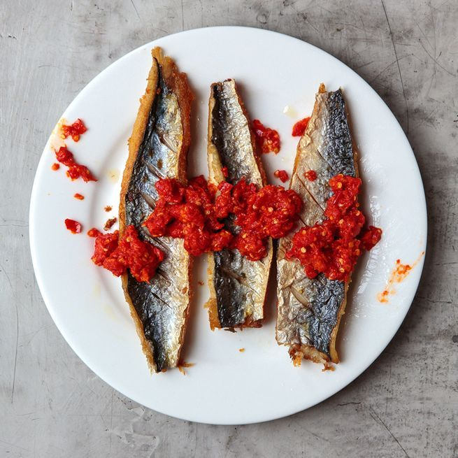 From SAVEUR Issue #163 In Padang, restaurants grill and fry small whole mackerel before smearing them with sambal, a spicy chile-based condiment. We find that the skin-on fillets of larger fish work just as well.