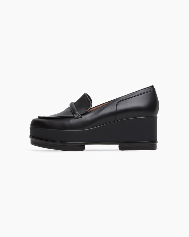 $595, Black Leather Platform Loafers: Robert Clergerie Yokole Wedge Loafer. Sold by La Garçonne. Click for more info: https://lookastic.com/women/shop_items/81832/redirect