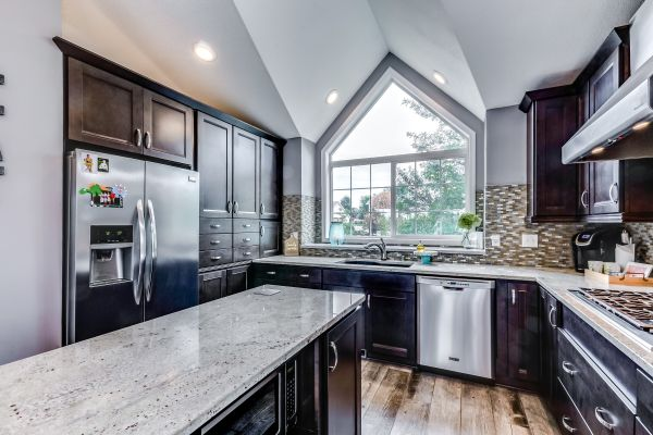 This fully-renovated kitchen features heated tile floors that look like wood, slow-close cabinetry in a chocolate color with white contrasting granite, gourmet stainless appliances and bright windows.   This home can be seen at 2195 Ponds Way in Shakopee.  Marketed by Chad & Sara Huebener, Edina Realty, chadandsara@edinarealty.com  952-212-3597