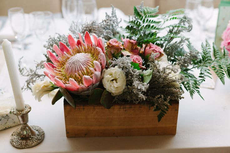 rustic arrangement with roses, slangbos, protea, lisianthius, fern. Wooden box wedding arrangement. Vintage wedding by www.ecochicweddings.co.za