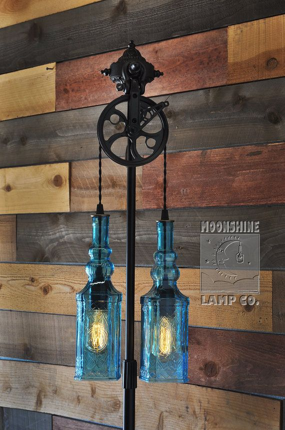 The Gatsby - a floor lamp made from recycled and repurposed bottles.  This one features recycled blue bottle with a Moroccan flair, and we just love the industrial style warehouse pulley.  We can make this with any two bottles.