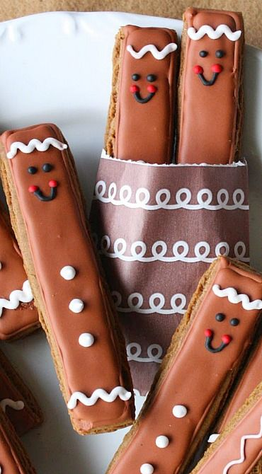 Gingerbread Men Cookie Sticks. Also link to monster and snowman cookie sticks. Too cute and you don't need a bunch of messy cookie cutters!