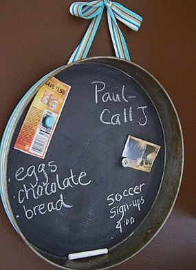 Old Cake Pan...re-purposed into a unique message board! Thrift stores & yard sales always have pans that you can buy for next to nothing...use chalkpaint, glue a ribbon on the back & use as a trash to treasure message/magnet chalkboard!!
