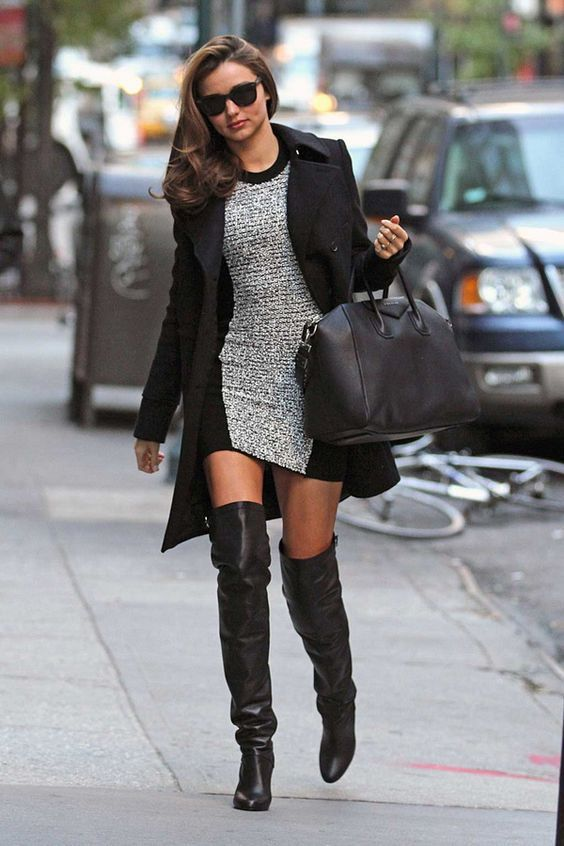 mini sweater dress topped with coat and paired with boots