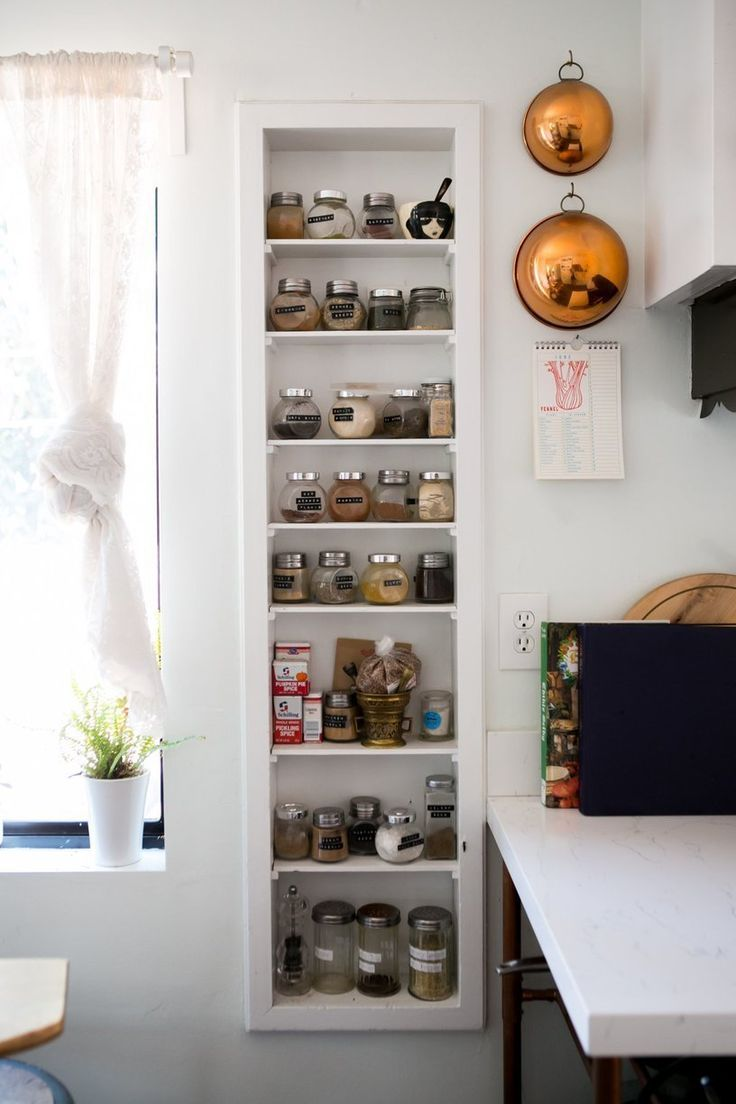 From Apartment Therapy. Great use of space between studs, but also, larger containers for often used spices. Easier to keep clean and containers always visually at the ready...