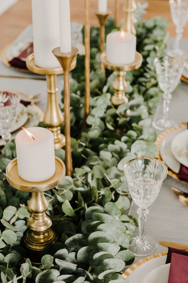 eucalyptus table runner - photo by Kai Heeringa Photography http://ruffledblog.com/modern-romantic-wedding-ideas-with-marsala