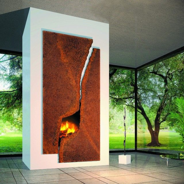 BRABBU loves the artistic and unique solution for the fireplace in the home. The choice of material is great, so as the sculptural and artistic shape and the fireplace being used as a decorative element and a piece of art in the home. Nice one!  #fireplace #rust #art #sculpture #nature #glass