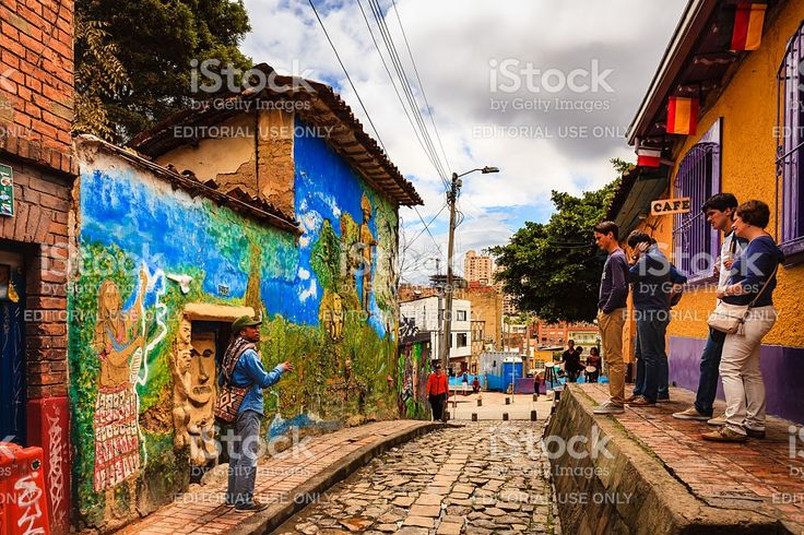 Bogota, Colombia - Tourists with Tour Guide in La Candelaria royalty-free stock photo