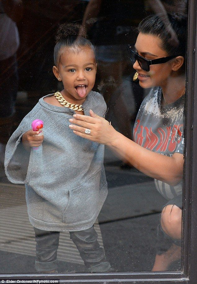 Look at me! North poked her tongue out at waiting photographers...: