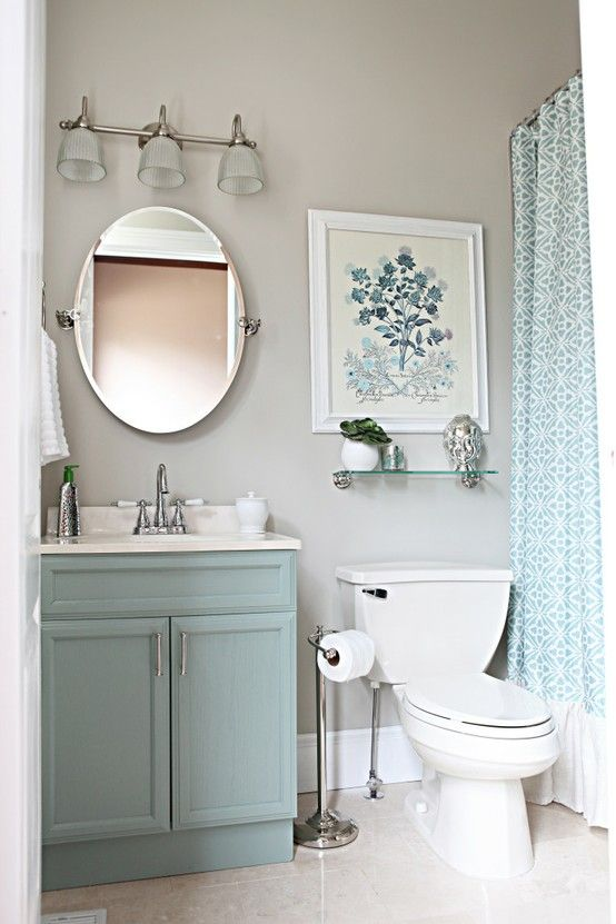 Great color scheme...dove walls, gray-blue cabinet, light blue shower curtain, and white with brushed metal fixtures