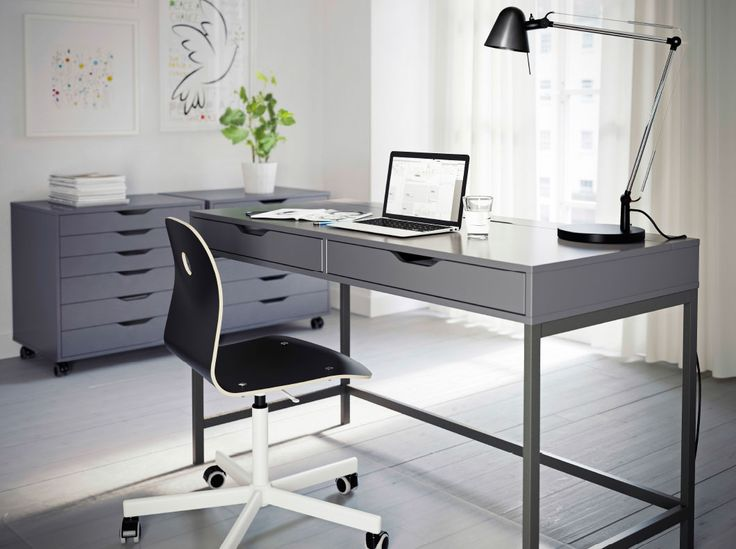 I adore these drawer units - would hold tons of goodies, mats, prints, frames, etc.  Only $119 each.  Desk $159 A grey home office with ALEX desk and drawer units in grey and VÅGBERG chair in black.