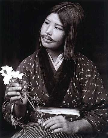 The Ainu women tattooed their mouths, and sometimes the forearms. The mouth tattoos were started at a young age with a small spot on the upper lip, gradually increasing with size. The soot deposited on a pot hung over a fire of birch bark was used for color.